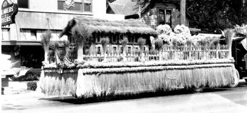 "Vehicle decorated for a parade, from the ""State Flax Industry"", decorations are made from flax, Courtesy of Oregon State Library"