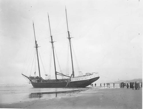 "Wreck of the ""Oakland"" of San Francisco, on Nehalem Spit, Tillamook County. The ""Oakland"" was a 3 masted sailing vessel, and ran aground on the beach., Courtesy of Oregon State Library"