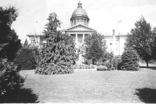 Main entrance to the Old Capitol Salem seen from the west, in Willson Park. 1876 Capitol Building from the East, with gardens in the foreground, after 1893 when dome was added., Courtesy of Oregon State Library