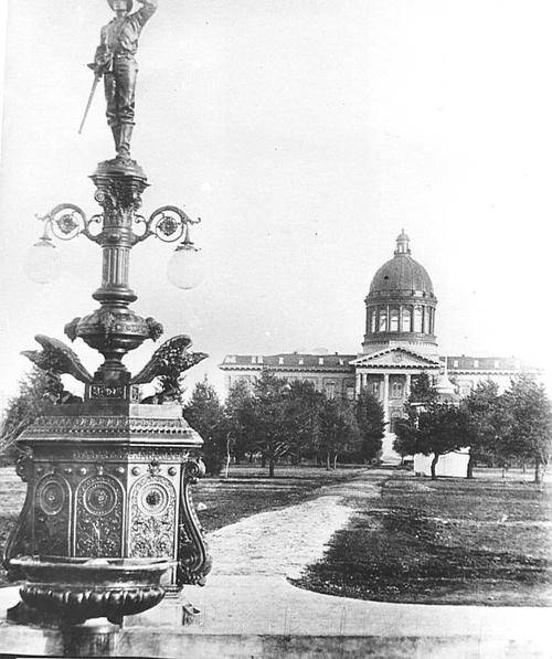 1876 Capitol Building, view from the West, after dome was added in 1893, with memorial statue in the foreground., Courtesy of Oregon State Library