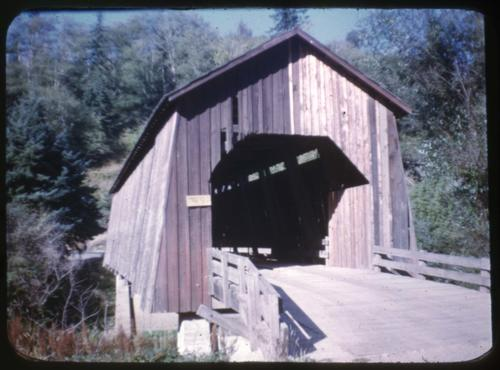 Chitwood bridge in Chitwood, Oregon, over Yaquina River is a 96 foot Howe covered bridge built in 1926. Location: T10S R9W S32, Photo by Glenn G. Groff., Courtesy of State Library of Oregon.