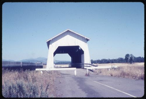 Bundy bridge, 5 miles northeast of Monroe, Oregon, over Long Tom River, is a 75 foot Howe covered bridge built in 1939. Location: T14S R5W S11, Photo by Glenn G. Groff., Courtesy of State Library of Oregon.