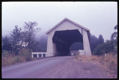 Hayden bridge, 2 miles west of Alsea, Oregon, over Alsea River, is a 91 foot Howe covered bridge built in 1913. Location: T14S R8W S2, Photo by Glenn G. Groff., Courtesy of State Library of Oregon.