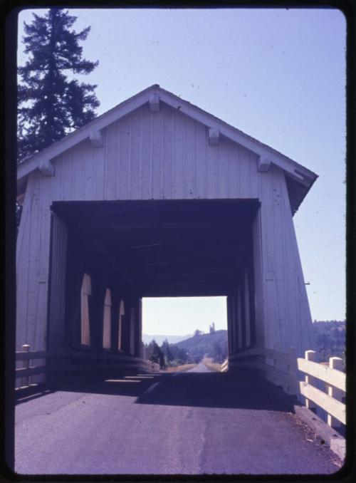 Ritner Creek bridge, 2 miles south of Pedee, Oregon, over Ritner Creek, is a state owned, 75 foot Howe covered bridge built in 1927. Location: T10S R6W S5, Photo by Nina M. Groff., Courtesy of State Library of Oregon.