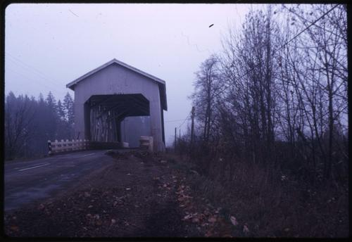 Bohemian Hall bridge, 5 1/2 miles southeast of Scio, Oregon, over Crabtree Creek, is a 132 foot Howe covered bridge built in 1947. Location: T10S R1W S34, Photo by Glenn G. Groff., Courtesy of State Library of Oregon.