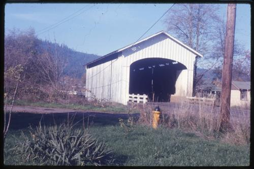 Marcola bridge in Marcola, Oregon, over Mohawk River is a 75 foot Howe covered bridge built in 1936. Location: T16S R1W S18, Photo by Glenn G. Groff., Courtesy of State Library of Oregon.