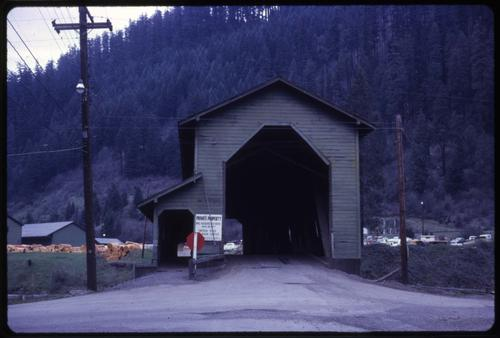 Office bridge in Westfir, Oregon, over the North Fork of Middle Fork Willamette River is a 180 foot Howe covered bridge built in 1944. Location: T21S R3E S18, Photo by Glenn G. Groff., Courtesy of State Library of Oregon.