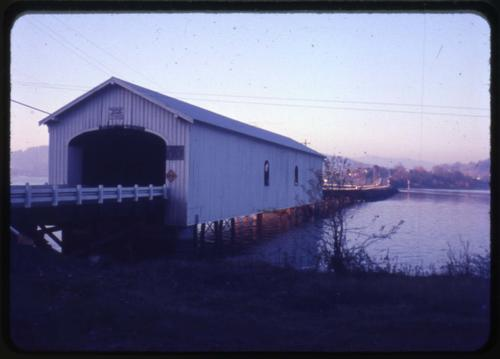 Lowell bridge in Lowell, Oregon, over Dexter Reservoir is a 165 foot Howe covered bridge built in 1945. Location: T19S R1W S23, Photo by Glenn G. Groff., Courtesy of State Library of Oregon.
