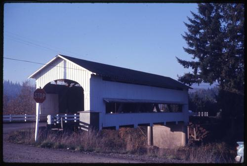 Unity bridge, 2 miles north of Lowell, Oregon, over Big Fall Creek, is a 90 foot Howe covered bridge built in 1936. Location: T19S R1W S2, Photo by Glenn G. Groff., Courtesy of State Library of Oregon.
