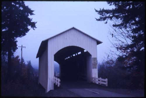 Mosby Creek bridge, 4 miles east of Cottage Grove, Oregon, over Mosby Creek, is a 90 foot Howe covered bridge built in 1920. Location: T21S R3W S1, Photo by Glenn G. Groff., Courtesy of State Library of Oregon.