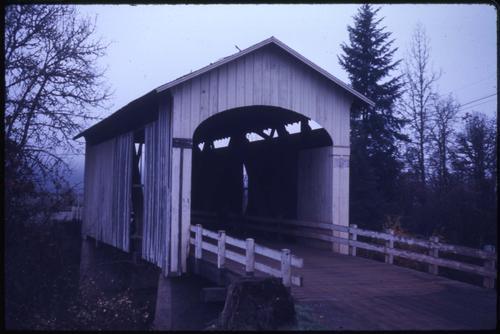 Stewart bridge, 4 1/2 miles south of Cottage Grove, Oregon, over Mosby Creek, is a 60 foot Howe covered bridge built in 1930. Location: T21S R3W S1, Photo by Glenn G. Groff., Courtesy of State Library of Oregon.