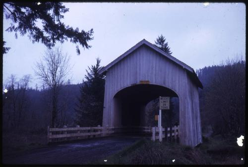 Booth bridge, 5 1/2 miles northeast of Yoncalla, Oregon, over Elk Creek, is a 42 foot kingpost covered bridge built in 1921. Location: T22S R5W S24, Photo by Nina M. Groff., Courtesy of State Library of Oregon.