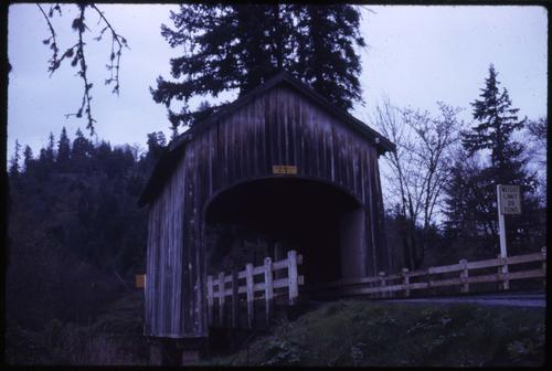 Booth bridge, 5 1/2 miles northeast of Yoncalla, Oregon, over Elk Creek, is a 42 foot kingpost covered bridge built in 1921. Location: T22S R5W S24, Photo by Glenn G. Groff., Courtesy of State Library of Oregon.