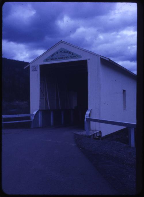 Milo Academy bridge in Milo, Oregon, over South Umpqua River is a 100 foot private, steel truss covered bridge built in 1962. Location: T30S R3W S26, Photo by Nina M. Groff., Courtesy of State Library of Oregon.