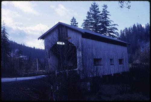 Cavitt Creek bridge, 6 miles southeast of Glide, Oregon, over Little River, is an 82 foot Howe covered bridge built in 1943. Location: T27S R3W S2, Photo by Glenn G. Groff., Courtesy of State Library of Oregon.