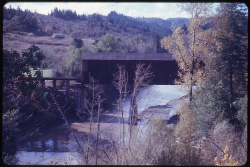 This G-P RR bridge, 3 1/2 miles south of Broadbent, Oregon, over South Fork Coquille River, is a 138 foot Howe covered bridge built in 1923. Location: T30S R12W S8, Photo by Glenn G. Groff., Courtesy of State Library of Oregon.
