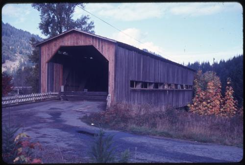The Bridge in Bridge, Oregon, over Middle Fork Coquille River is a 150 foot Howe covered bridge built in circa 1936. Location: T29S R11W S33, Photo by Glenn G. Groff., Courtesy of State Library of Oregon.
