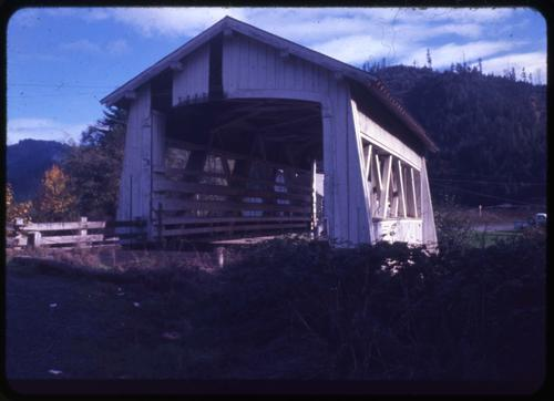Sandy Creek bridge in Remote, Oregon, over Sandy Creek is a 60 foot Howe covered bridge built in 1921. Location: T29S R10W S33, Photo by Nina M. Groff., Courtesy of State Library of Oregon.