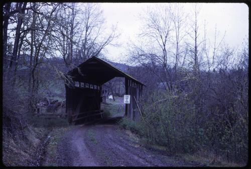 Lost Creek bridge, 3 miles southeast of Lakecreek, Oregon, over Lost Creek, is a 40 foot queenpost covered bridge built in 1919. Location: T37S R2E S3, Photo by Glenn G. Groff., Courtesy of State Library of Oregon.