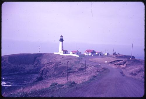Yaquina Head lighthouse and scenic viewpoint in Newport, Oregon., Photo by Glenn G. Groff., Courtesy of State Library of Oregon.