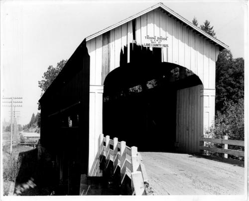 Thorne covered bridge is a 120 foot Howe truss bridge spanning the Coast Fork of the Willamette River 1 mile north of London in Lane County, Oregon, on county road 764 at milepost 11.6. The bridge was built in 1925 for $4,200 and was removed in the 1960s. Location: T22S R3W S20, Courtesy of State Library of Oregon.