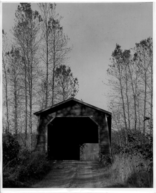 The Shimanek covered bridge spanned Thomas Creek near Scio in Linn County, Oregon. The 130 foot bridge was built in 1927, was damaged by the 1962 Columbus Day storm, and replaced by a new covered bridge in 1966., Courtesy of State Library of Oregon.