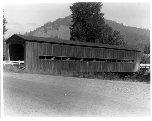 This covered bridge spanning Middle Fork Coquille River at Bridge in Coos County, Oregon, is a 150 foot Howe truss bridge built in 1936 by the Works Progress Association (WPA). It was removed in 1969 after a snowfall damaged the structure., Courtesy of State Library of Oregon.