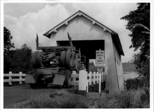 Covered bridge over Ritner Creek near Pedee, Oregon in Polk County. This 75 foot Howe truss bridge was built in 1927., Courtesy of State Library of Oregon.