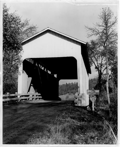 Bridgeport covered bridge, also known as the Old White Bridge, has a 72 foot Howe truss and spans Little Luckiamute River near Monmouth in Polk County, Oregon. The bridge was removed in October 1950., Courtesy of State Library of Oregon.